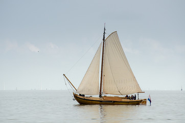 Beautiful white yacht sailing at IJsselmeer bay. Netherlands