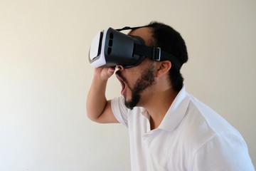 Man wearing VR headset surprise