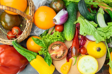 vegetable mix of tomatoes, zucchini, onion, cucumber, pepper, basil, lettuce. mix of colors