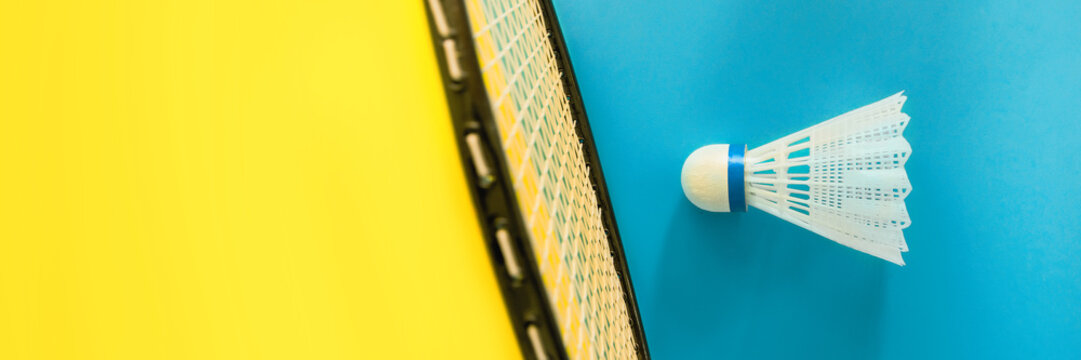 Volant and racket for playing badminton on yellow background. The concept of summer entertainment. Minimalism Pop Art