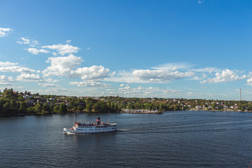 10 July 2018 Stockholm, Sweden: Steamship full of tourists. Popular means to get around. Beautiful views of the Swedish islands on a sunny day.