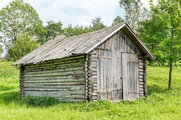 Old wooden barn in forest.