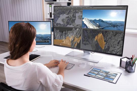 Woman Rendering 3D Landscape On Computer