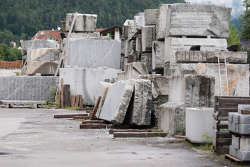 Large blocks of rough granite in a quarry