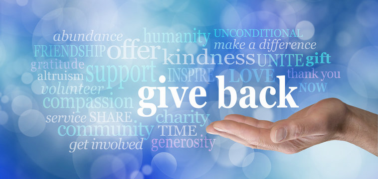 GIVE BACK word tag cloud - male hand with the words GIVE BACK floating above surrounded by a word cloud against a blue bokeh background
