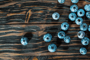 Bilberries on vintage wooden board