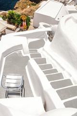 Architecture of the island of Santorini, Thira, Greece. A cozy place to view the caldera of the volcano.