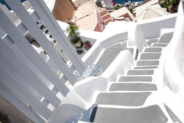 Architecture of the island of Santorini, Thira, Greece. Descent on the white staircase