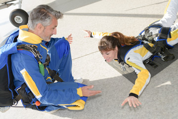 Lady practicing position for parachute jump
