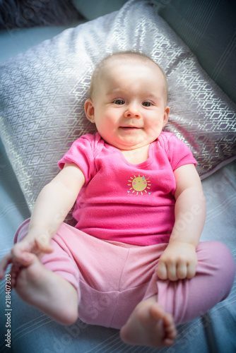 e9fed5d4a83d Sweet adorable baby girl grabbing legs looking towards camera. 6-7 ...