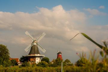 historic windmills at greetsiel, germany