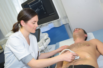 female doctor with male patient undergoing echography