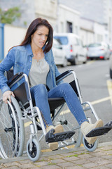 disabled woman trying hard to move in the city