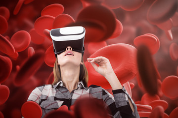 Woman in VR glasses, red eritrosit background
