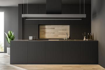 Wooden floor kitchen interior, black countertops