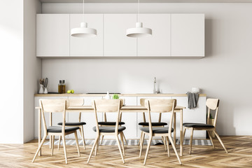Modern white dining room and kitchen