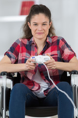 young handicapped woman playing video games at home