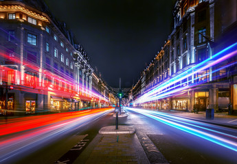 Fototapeten London roten bus Regent Street at night with beautiful night trail.