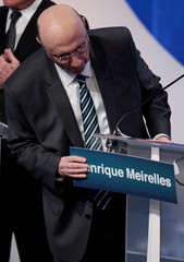 Presidential candidate Henrique Meirelles of the Brazilian Democratic Movement (MDB) checks a card with his name before a television debate at the Rede TV studio in Osasco