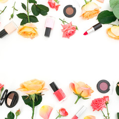 Floral frame with roses flowers and feminine make up cosmetics on white background. Flat lay, top view.