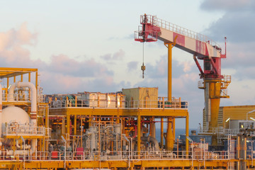 Crane construction on Oil and Rig platform for support heavy cargo. Transfer cargo or basket on work site, Heavy industry, heavy job on the oil and gas platform, Offshore operation on the platform. .
