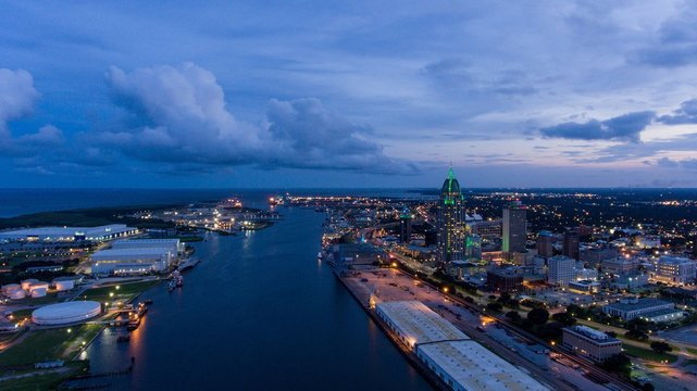 Aerial view of downtown Mobile, Alabama riverside at sunset
