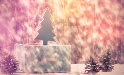 Old box with vintage Christmas handmade toys on a withered wooden background