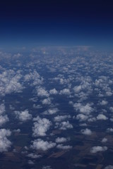 Небо. Облака. Земля с высоты. Виды из окна самолёта. Полёт. Поля облаков.