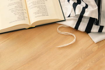 Prayer Shawl - Tallit and Prayer book jewish religious symbols. Rosh hashanah (jewish New Year holiday), Shabbat and Yom kippur concept.