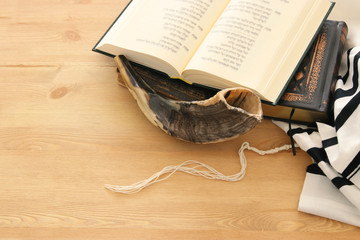 Prayer Shawl - Tallit, Prayer book and Shofar (horn) jewish religious symbols. Rosh hashanah (jewish New Year holiday), Shabbat and Yom kippur concept