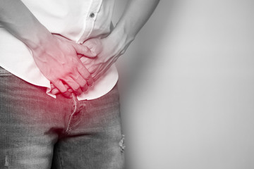 Male hands holding on middle crotch of trousers with prostate inflammation, Prostate cancer, Men's health care concept.