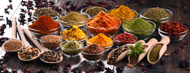 Foto op Canvas Kruiden Variety of spices and herbs on kitchen table