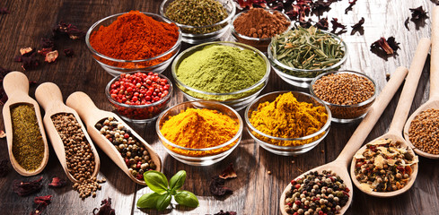 Variety of spices and herbs on kitchen table