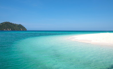 Landscape view of beautiful beach, sea sand sun at Lipe, Sa Toon province in south of Thailand with blue sky and white beach for relax, vacation and your long holidays to driving scuba tropical Island