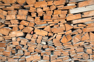 brown wood texture for background or wallpaper, wall, wood stack.Cross section of timber, beams, logs, blocks.