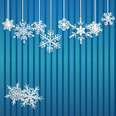 Christmas illustration with white hanging snowflakes on blue striped background