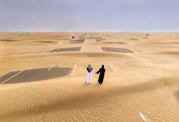 emirati couple in a desert