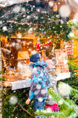 Christmas market under the snow in France, in Strasbourg, Alsace