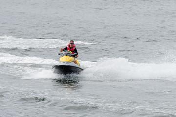 Foto op Plexiglas Water Motor sporten young man on a water motorcycle