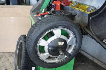 Tire changing in an auto repair shop