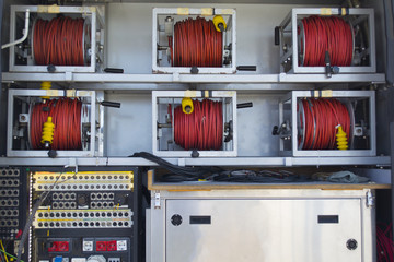 Transmission line behind and electronic, power cables network the outside broadcasting van.
