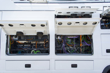 Transmission line behind and electronic cable network the outside broadcasting van.