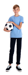 Portrait of young boy holding soccer ball on white background