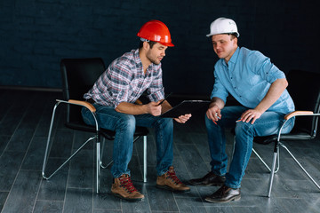 two engineers are concentrated on the choise of materials. full length photo