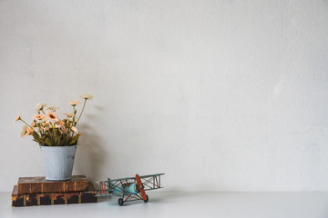 Workspace desk books, house plant, airplane model with copy space