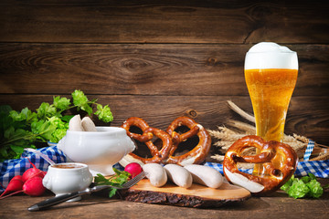 Bavarian sausages with pretzels, sweet mustard and beer