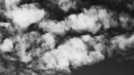 Abstract dark grey background from a cloudy sky. Black and white view