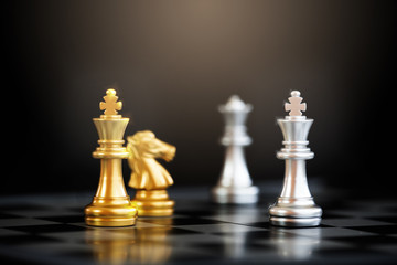 Close up chess pieces on chessboard with black background