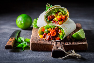 Spicy burrito made of lettuce and vegetables with red salsa