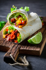 Closeup of burrito made of lettuce and vegetables